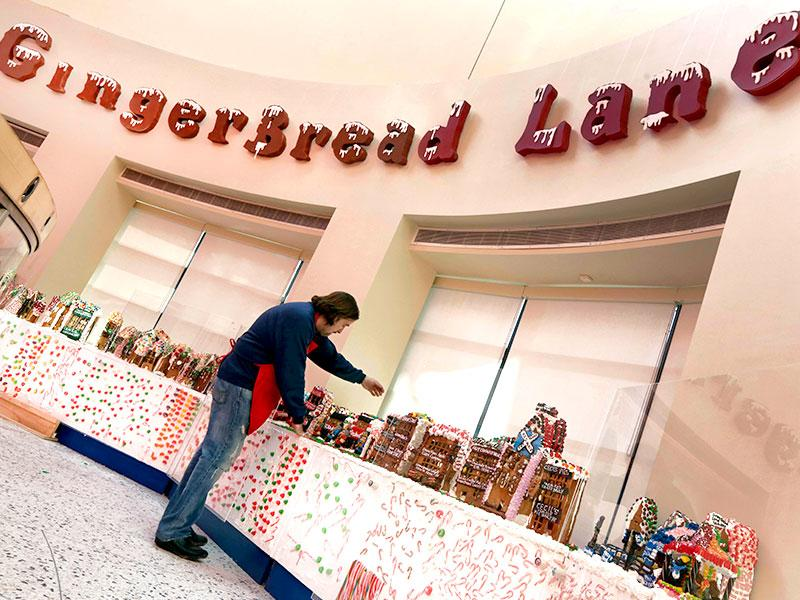 Chef Jon Lovitch arranges some of his gingerbread house creations in the GingerBread Lane display, at the New York Hall of Science, in the Queens borough of New York. (AP photo)
