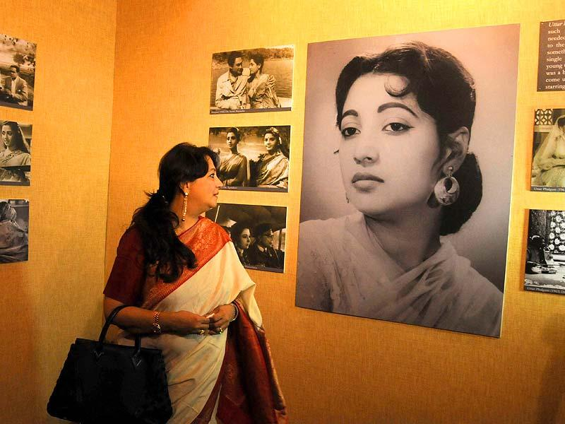 Actor turned Trinomul Congress MP Moon Moon Sen along with artist Subhaprassaanna and actor Ranjit Mullick during a photo exhibition on her mother and actor Suchitra Sen at Gaganendra Nath exhibition hall as a part of 20th Kolkata International Film Festival in Kolkata, on Nov 11, 2014. (IANS)