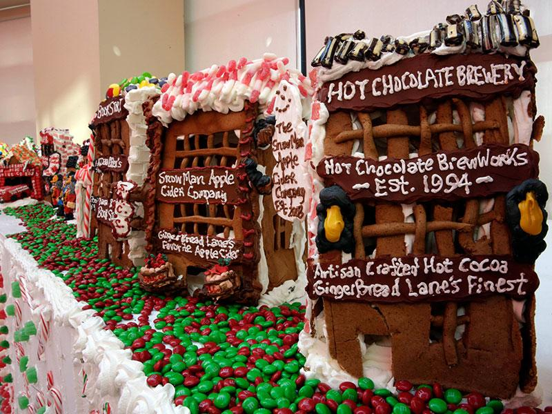 Some of the gingerbread house creations by chef Jon Lovitch are displayed in his GingerBread Lane, at the New York Hall of Science, in the Queens borough of New York.  (AP photo)