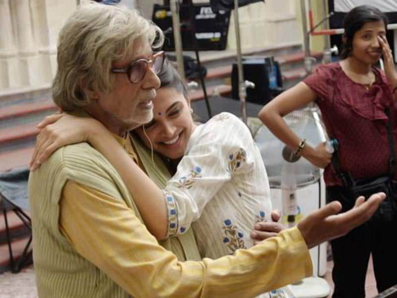 Amitabh Bachchan and Deepika Padukone captured in a sweet moment on the sets of Shoojit Sircar's Piku.