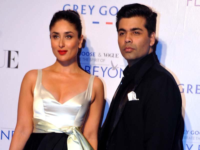 Kareena Kapoor Khan and Karan Johar strike a pose at Grey Goose Fly Beyond Awards. (AFP Photo)