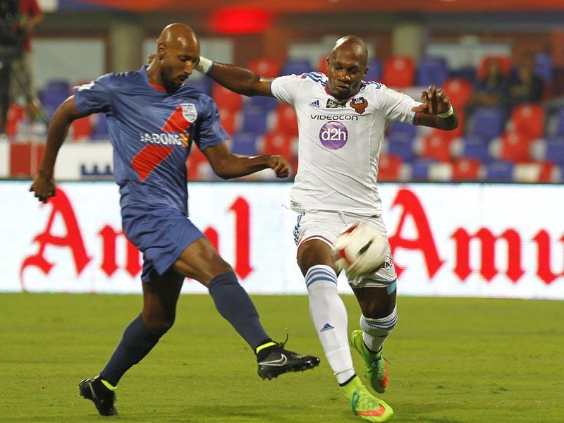 Player of Mumbai FC Nicolas Anelka and FC Goa (White) Gregory Arnolin in action during Hero India Super League match at D.Y. Patil in Mumbai. (Anshuman Poyrekar/HT Photo)