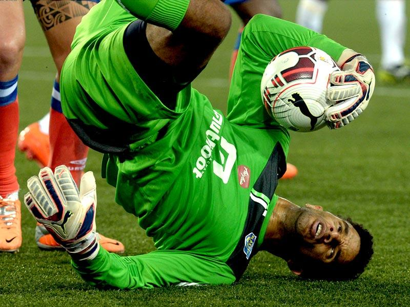 Kerala Blasters FC goalkeeper David James holds onto the ball after a save during the Indian Super League (ISL) football match between Atletico de Kolkata and Kerala Blasters FC at The Salt Lake Stadium in Kolkata. (AFP Photo)