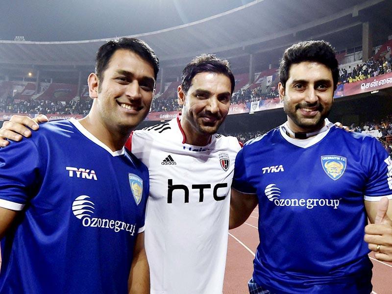 Chennaiyin FC co-owners MS Dhoni, Abhishek Bachchan and NorthEast United FC co-owner John Abraham share a light moment during the Indian Super League match between Chennaiyin FC and NorthEast United FC, in Chennai. (PTI Photo)