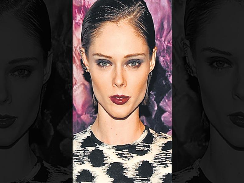 Model Coco Rocha stuns in a brighter shade of plum. She keeps the drama going with the grey smokey eyes, which only add more to the look.
