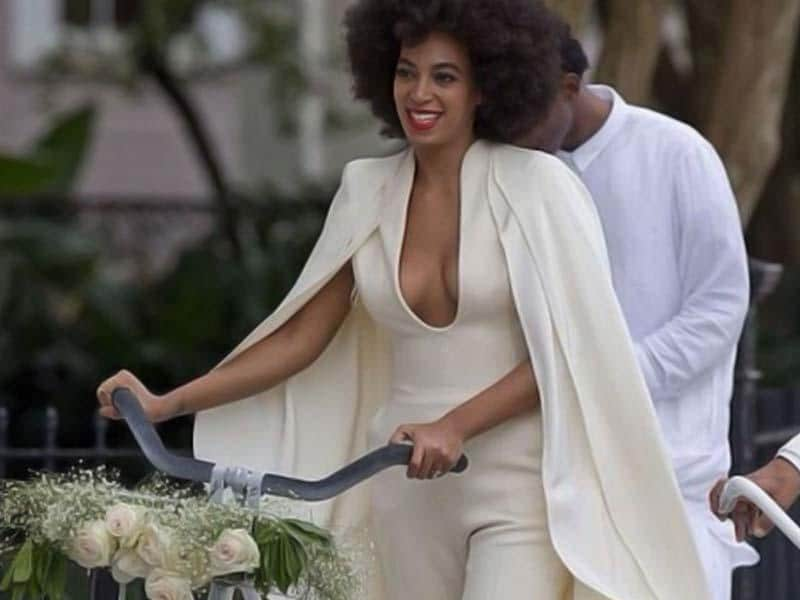 Here she is dragging a bike in her pretty white cape. Brace yourselves people, you are going to get bombarded with Solange themed wedding pics soon in your newsfeed!