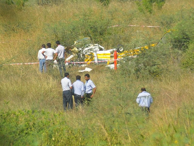 One trainee pilot was killed and another seriously injured when a trainer aircraft of the Madhya Pradesh Flying Club crashed in Indore on Wednesday. (Arun Mondhe/HT photo)