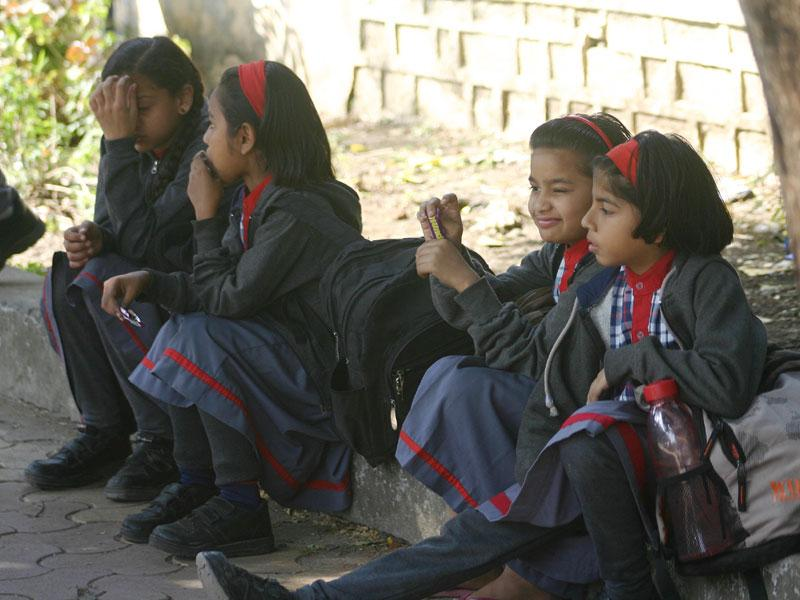 Students of Kendriya Vidyalaya No. 2 wait for their parents outside the school as van operators go on an indefinite strike in Bhopal. (Bidesh Manna/HT photo)