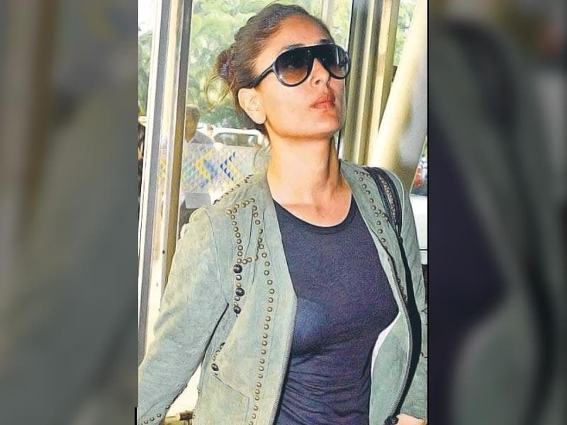 Bollywood celebs were spotted breezing in and out of the Mumbai airport. Actor Aamir Khan was seen with wife Kiran Rao after returning from Salman Khan's sister, Arpita Khan's wedding in Hyderabad. Kareena Kapoor Khan looked chic in a pair of skinny jeans with tan boots. Also seen were actors Sonam Kapoor, Varun Dhawan, Anushka Sharma with cricketer Virat Kohli and filmmaker Karan Johar among others.