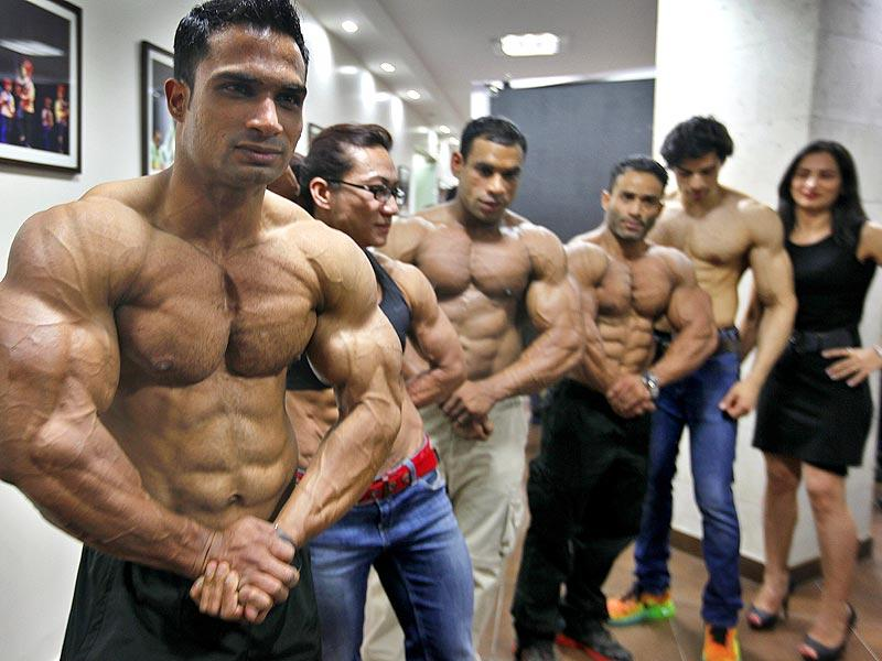 Body Builders pose during a photo call after the press conference of IBBF 6th World Body Building Championship 2014 in India, at Russian culture center in New Delhi. (Raj k Raj/ Hindustan Times)