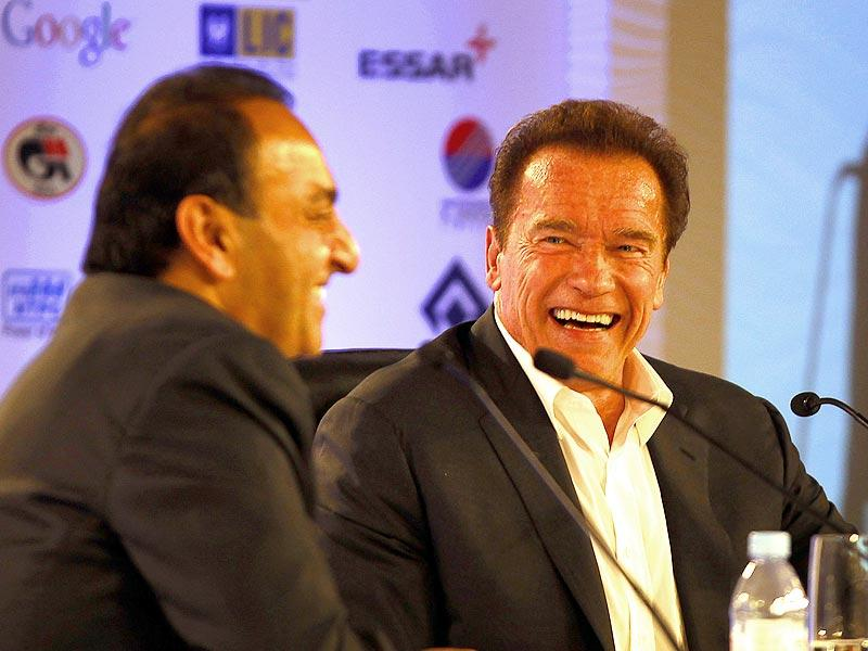 Schwarzenegger and Riz Khan share a light moment during the session. (Ajay Aggarwal/ HT Photo)