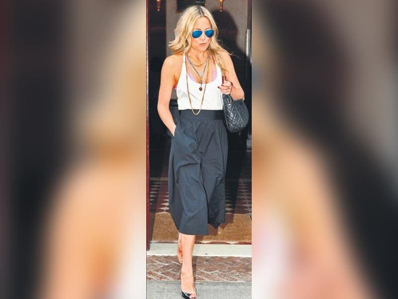 Gauchos are wide-legged cropped pants, hailing from the 70s South American cowboy background. While they may look like their flowy French counterpart, the culottes, gauchos are less-billowy and are meant to resemble cropped pants, unlike the skirt-like nature of the culotte. (Text: Sanya Goel) Kate Hudson style her gaucho with a contrasting top and heels for a casually chic look.