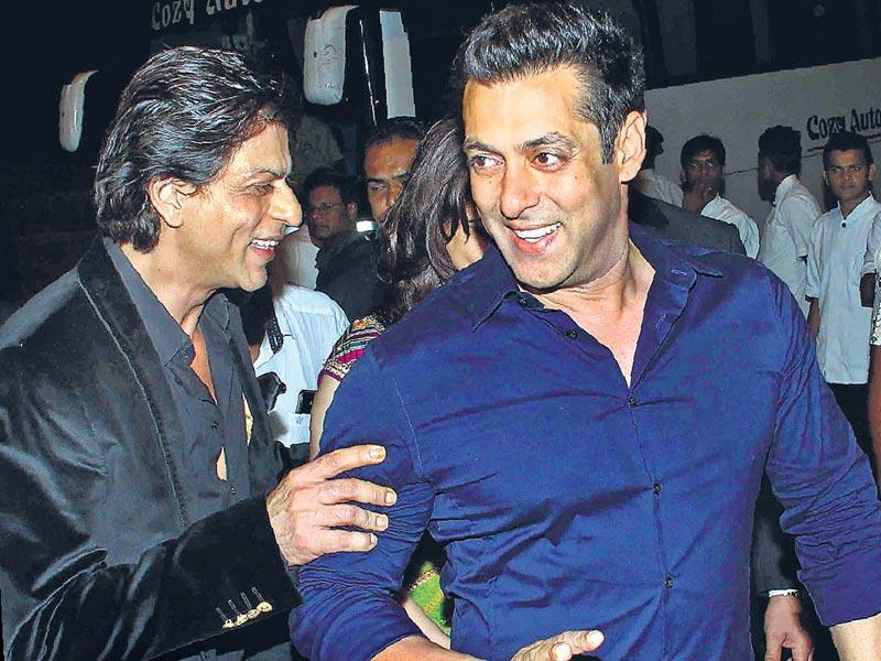 After Shah Rukh kissed Arpita on her forehead at the Sangeet, he was spotted at the newlyweds' star-studded reception on Friday, too. Here, he is seen sharing a laugh with Salman Khan. (Yogen Shah/ HT Photo)