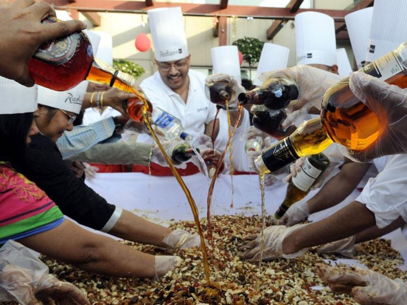 Christmas festivities begin in Indore with a cake mixing ceremony at Radisson Blu Hotel. Roughly 40 kilograms of dry fruits were kept to soak in liquor. (Amit K Jaiswal/HT photo)