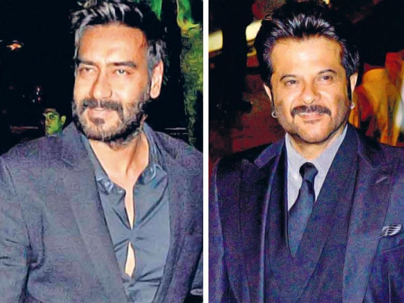 Ajay Devgn and Anil Kapoor at Arpita's reception. (Yogen Shah/HT photo)