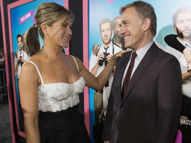 Jennifer Aniston and Christoph Waltz talk at the premiere of Horrible Bosses 2. (AFP)