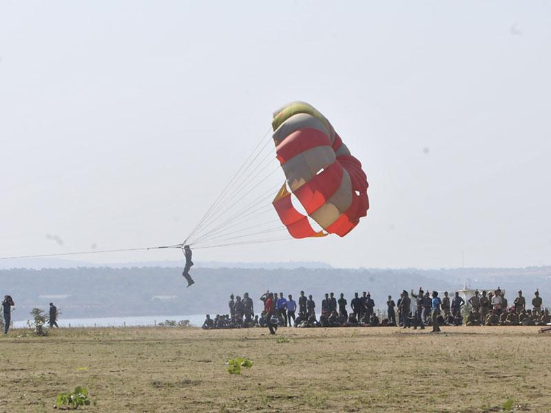 An NCC cadet enjoys parasailing at the 66th NCC Camp organised at Kaliasot dam in Bhopal on Sunday. (Mujeeb Faruqui/HT photo)