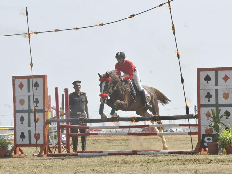 An NCC cadet enjoys horse riding at the 66th NCC Camp organised at Kaliasot dam in Bhopal on Sunday. (Mujeeb Faruqui/HT photo)