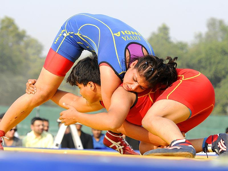 Women wrestlers in action during the 'Grand Wrestling Championship' organised by national sports club of India at NSCI Mathura Road in New Delhi. (Sonu Mehta/HT Photo)