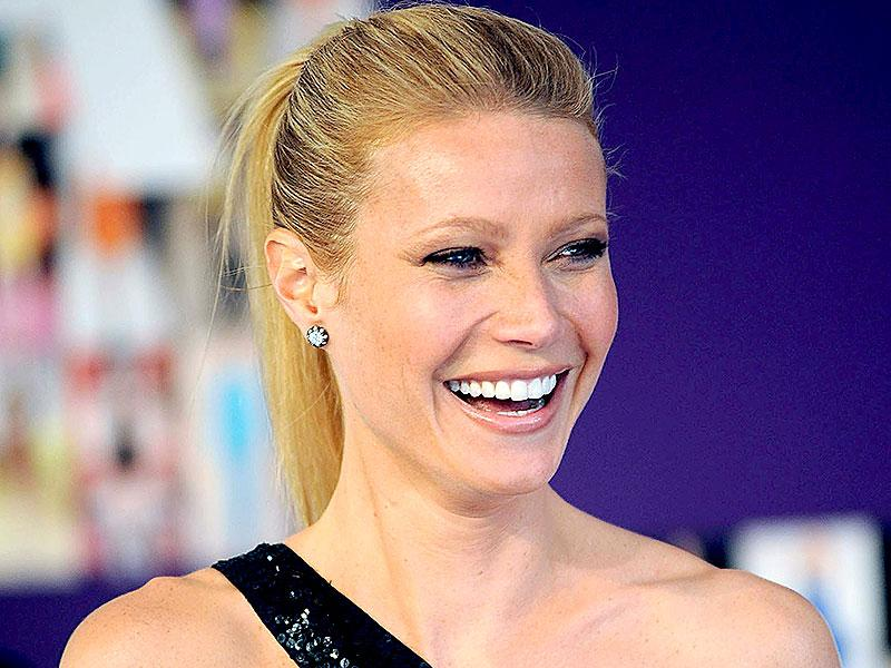 Pep up with ponytail: A perfect Friday hairstyle- just tie a loose regular ponytail, and then just above the ponytail, create a space in the centre using your two fingers and pass the ponytail through it. That's it! Take inspiration from Gwyneth Paltrow. (Photo: Shutterstock)