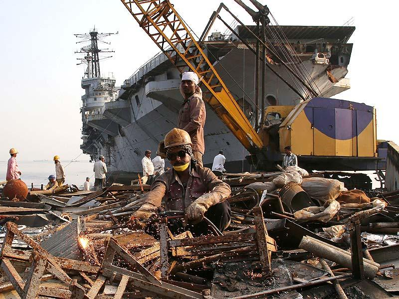 Workers dismantle India's first aircraft carrier INS Vikrant at a ship-breaking yard in Mumbai. (AP photo)