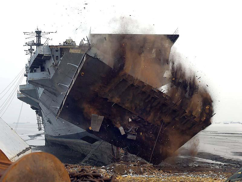 Workers dismantle India's first aircraft carrier INS Vikrant at a ship-breaking yard in Mumbai. (PTI photo)