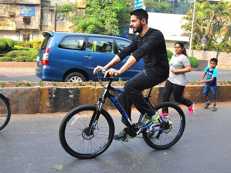Actor Sidharth Malhotra cycles at The Equal Street Movement in Bandra, Mumbai on November 24, 2014. He hails from Delhi and comes from a non-Bollywood background. (IANS)