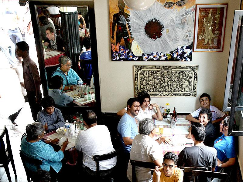 A file photo of Leopold Cafe six months after the 26/11 terror attacks - nothing had changed and the place was buzzing with activity. (HT file photo)