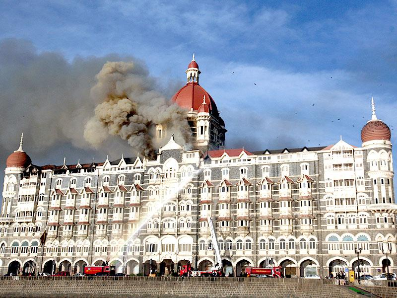 Fire engulfed a part of the Taj Hotel in Mumbai. Heavily armed gunmen stormed the luxury hotel on November 26, 2008. (HT file photo)