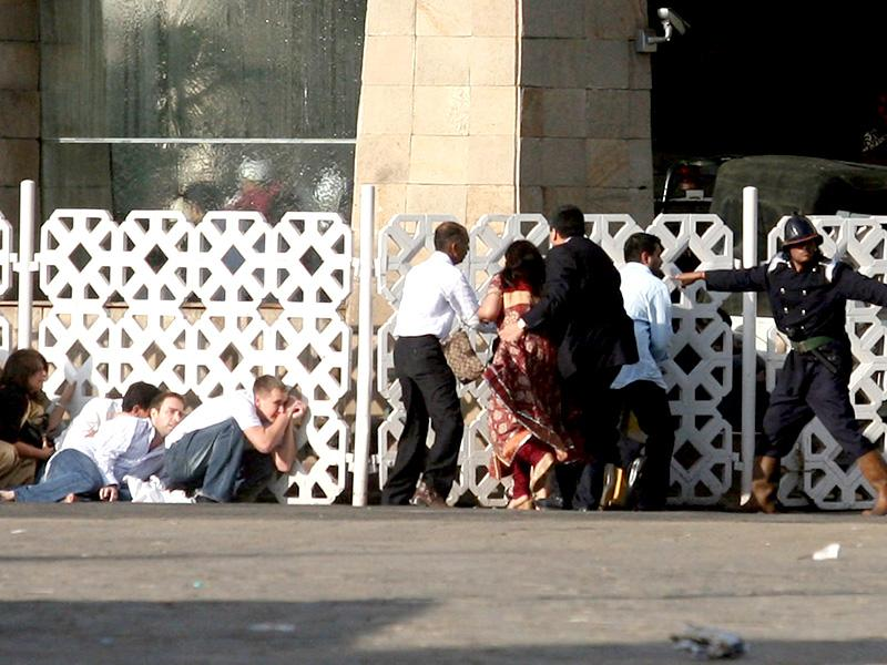 People took cover as the gunmen continued firing inside the Taj Mahal Hotel during the terror attacks. (HT file photo)