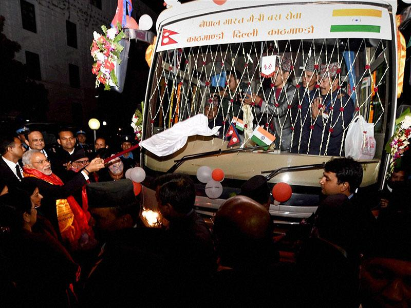 Prime Minister Narendra Modi flags off India-Nepal bus service in Kathmandu. (PTI photo)