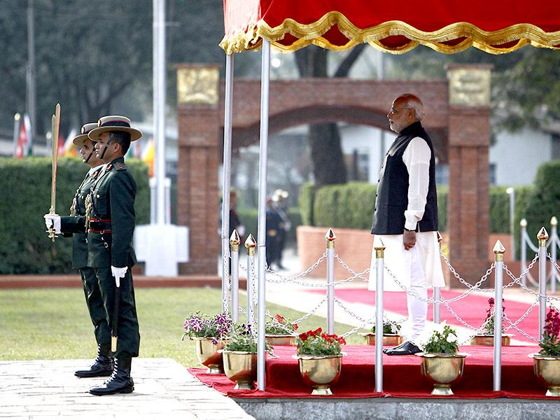 Prime Minister Narendra Modi watches a guard of honour upon his arrival for the 18th South Asian Association for Regional Cooperation (SAARC) summit in Kathmandu. (Reuters)