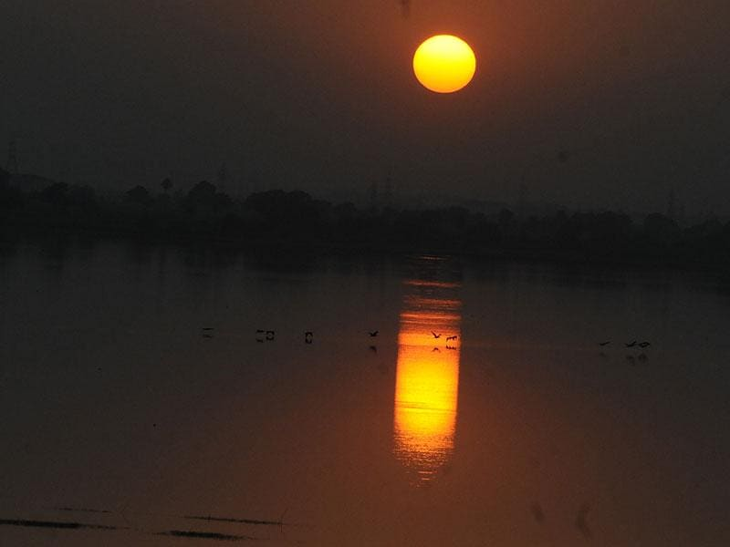 The sunset as seen from Bilawali Lake in Indore on Wednesday. (Arun Mondhe/HT photo)