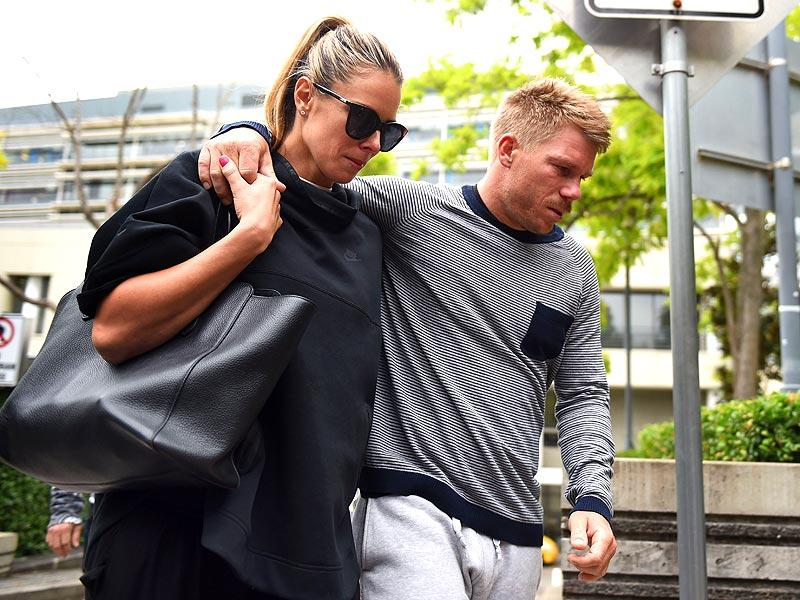Australian batsman David Warner and his wife Candice Falzon leave St Vincent's Hospital following the death of fellow Australian batsman Phillips Hughes in Sydney. (AFP Photo)