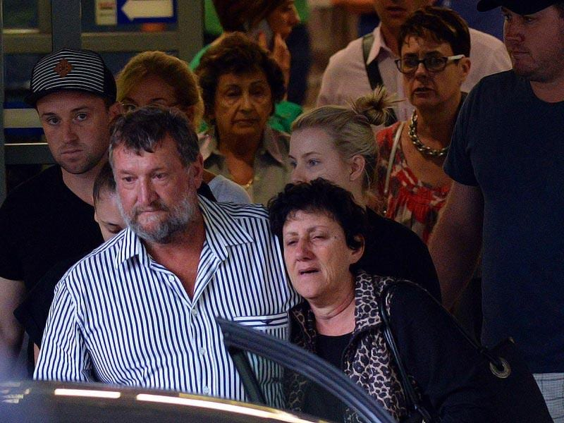 The parents of Australian cricket batsman Phil Hughes, father Greg and mother Virginia with other family members leave St Vincents Hospital. (AFP Photo)