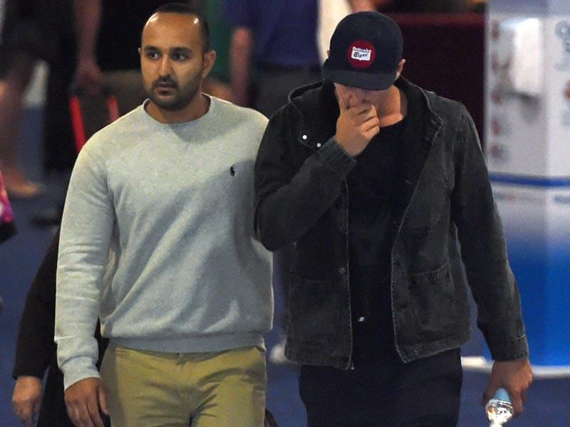 Australian bowler Sean Abbott (R) leaves St Vincent's Hospital following the death of fellow Australian batsman Phillips Hughes. (AFP Photo)