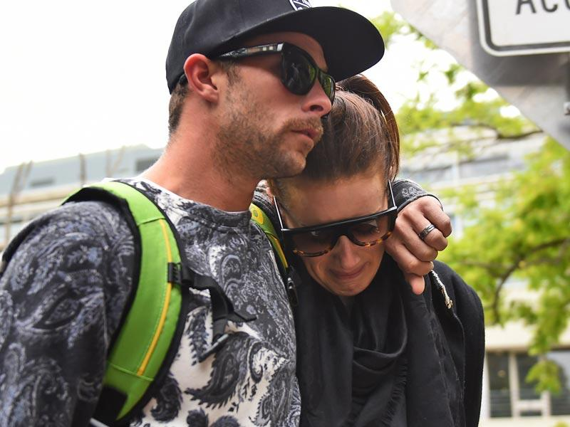 Australian wicketkeeper Matthew Wade and his partner Julia Barry leave St Vincent's Hospital following the death of fellow Australian batsman Phillips Hughes. (AFP photo)