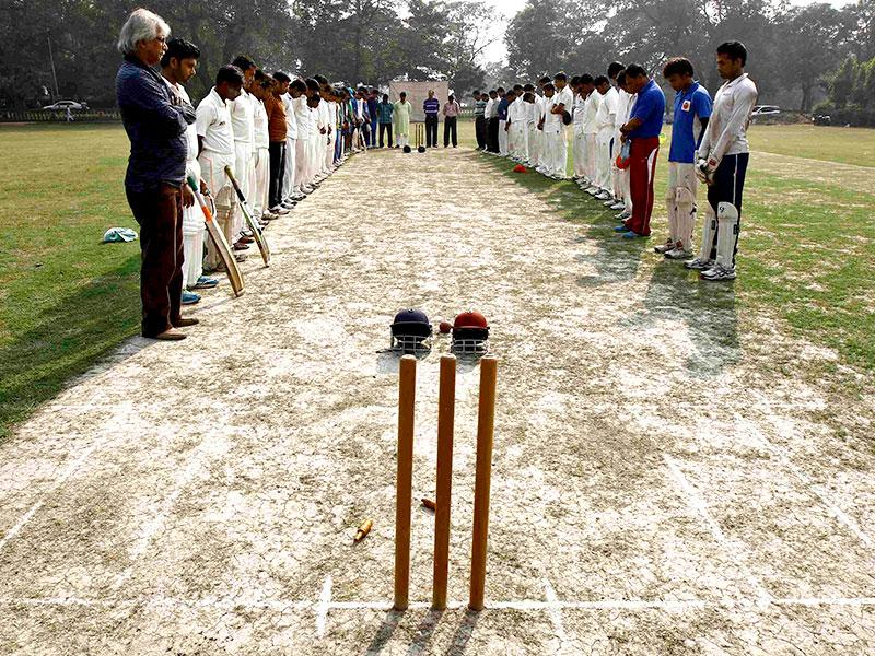 Members of two local cricket teams observe a moment of silence for Australian cricketer Phillip Hughes before their match in Kolkata. (Reuters)