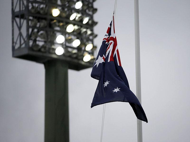 The Australian flag flies at half mast under lights at the Sydney Cricket Ground following the announcement of the death of Australian cricketer Phillip Hughes in Sydney. (Reuters)