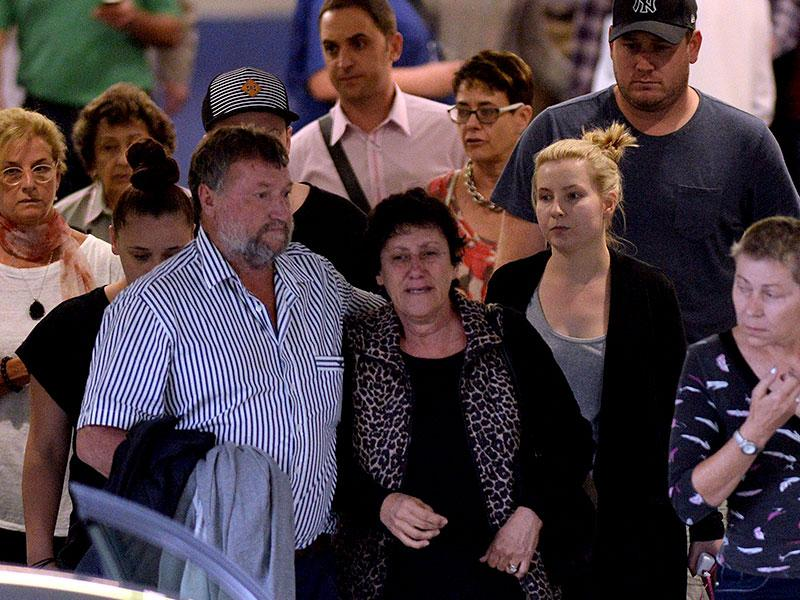 The parents of Australian cricket batsman Phil Hughes, father Greg (C) and mother Virginia (2nd R) with other family members leave St Vincents Hospital in Sydney. (AFP photo)