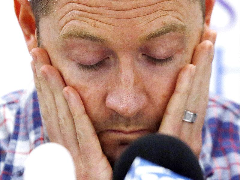 Australian cricket captain Michael Clarke pauses before delivering a statement, on behalf of the family of deceased teammate Phillip Hughes, at St Vincent's Hospital in Sydney. (Reuters)