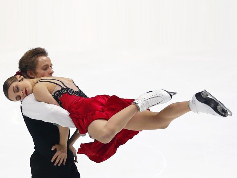 Kaitlin Hawayek and Jean-Luc Baker of the United States perform during the ice dance short program of the NHK Trophy figure skating in Osaka, western Japan. (AP Photo)