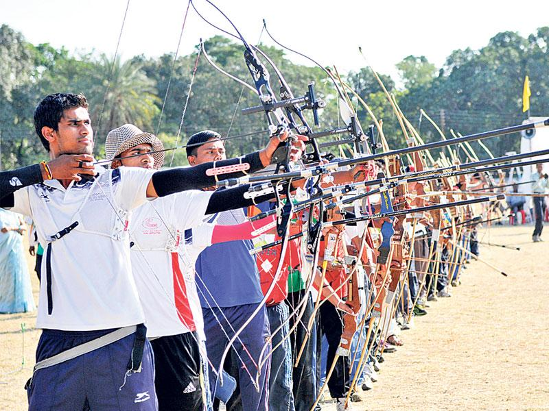Archery enthusiasts take part in the 12th junior and 7th mini-state archery competitions organised by MP Amateur Archery Association, in Bhopal on Sunday. (Mujeeb Faruqui/HT photo)
