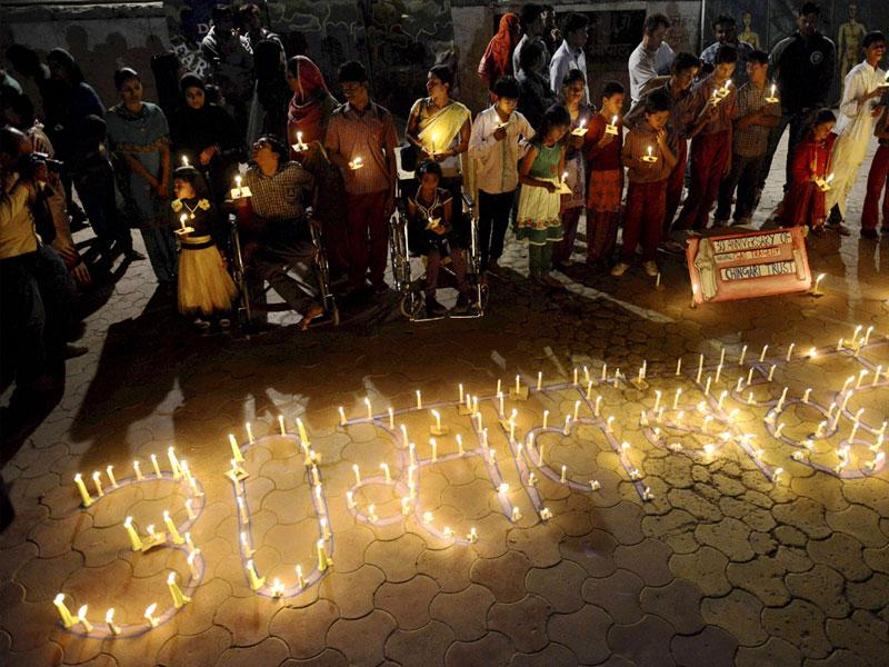 Victims of Bhopal gas tragedy take part in a candle lit vigil to mark the 30th anniversary of the tragedy. (PTI photo)