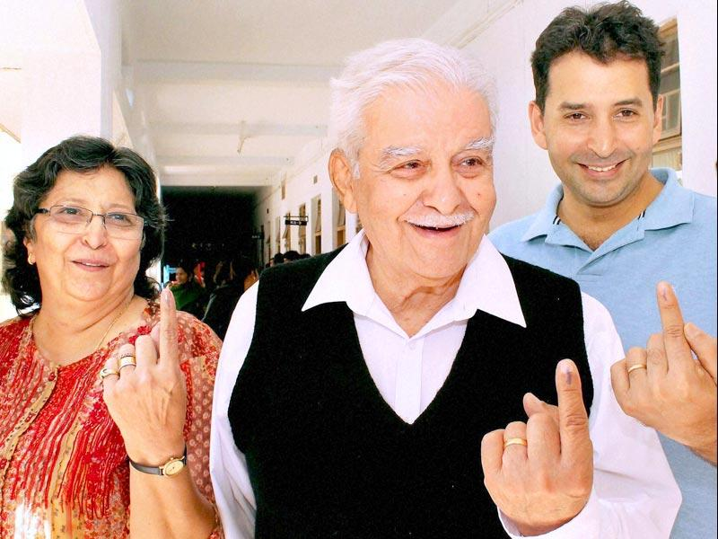 Tata steel former MD J J Irani along with wife after casting his votes for Assembly elections at a polling centre in Jamshedpur. (PTI Photo)