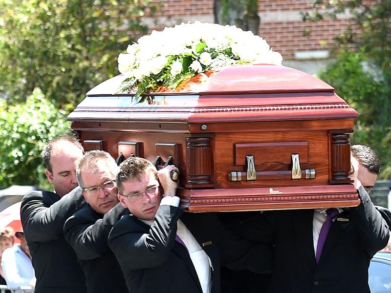 Pallbearers carry HUghes' coffin ahead of his funeral in Macksville on Wednesday. (AFP Photo)