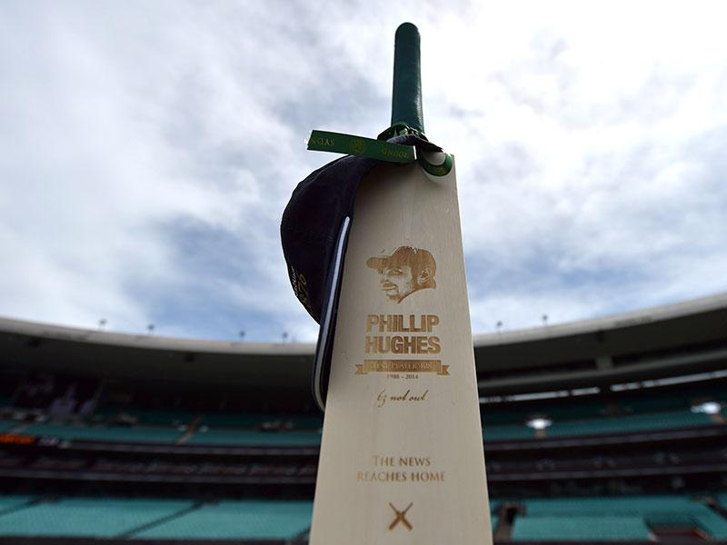 One of the 63 bats detailing Phillip Hughes' career during the memorial service at the Sydney Cricket Ground. (AFP Photo)