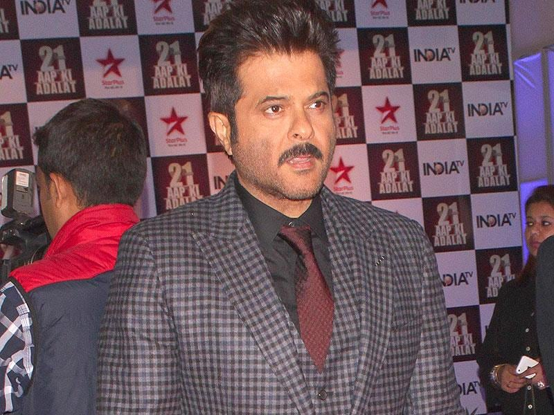 Actor Anil Kapoor during a programme organised to celebrate 21 years of a TV show at Pragati Maidan in New Delhi on Dec 2, 2014. (IANS)