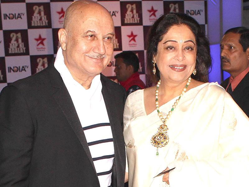 Actors Anupam Kher and Kirron Kher during a programme organised to celebrate 21 years of a TV show at Pragati Maidan in New Delhi on Dec 2, 2014. (IANS)