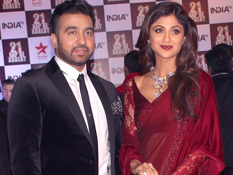 Actor Shilpa Shetty with her husband during a programme organised to celebrate 21 years of a TV show at Pragati Maidan in New Delhi on Dec 2, 2014. (IANS)